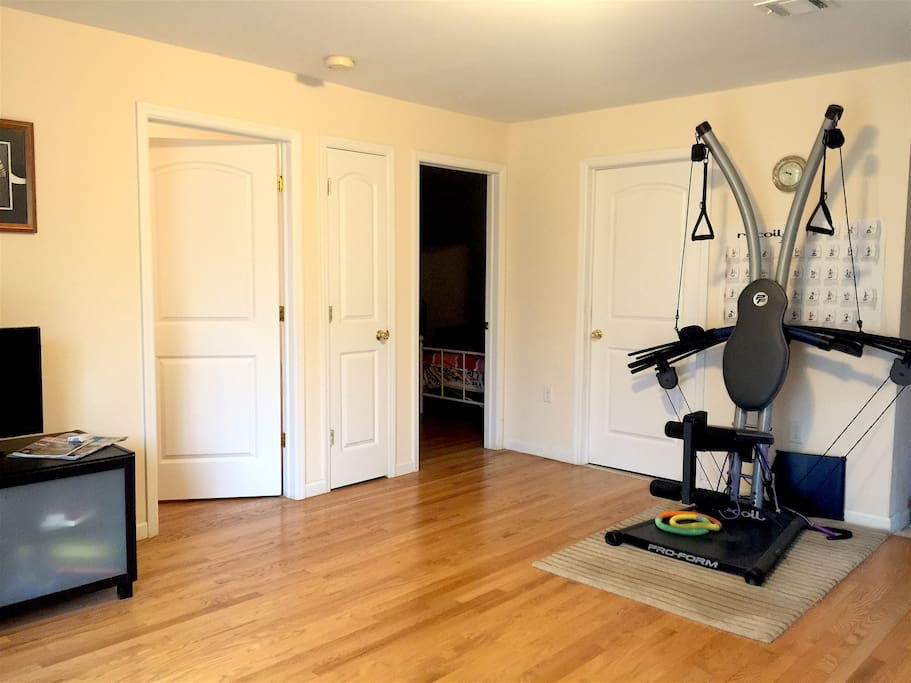 Guest living room with exercise machine (leads into two bedrooms)