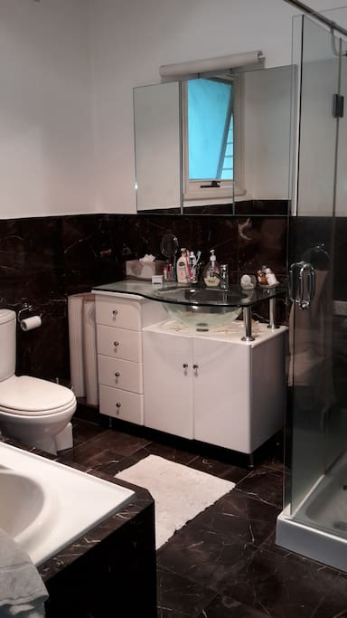 Bathroom with toilet and ajacent to a separate toilet room