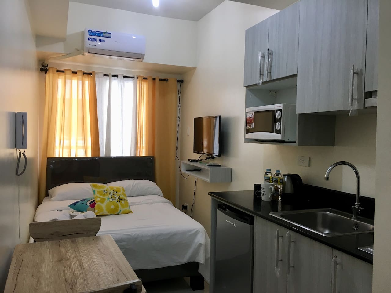 """A16sqm studio unit that is fully air-conditioned and equipped with double bed comfortable for 2, 32"""" LED local tv, pocketWiFi(by request), kitchenette with electric stove, iron, mini fridge, microwave, and coffee making facilities."""