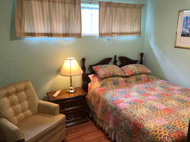 Bedroom 2.  Has a nice window that opens.  Queen sized bed, very comfy with nice linens, blankets.
