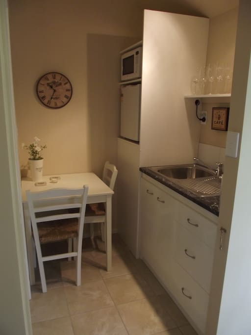 Kitchenette with Dining Table with fridge and microwave