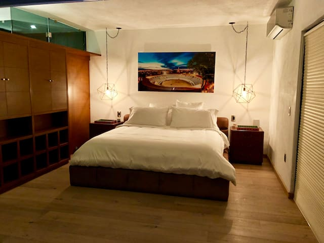This bed will hug you until you fall asleep, The art piece is a photograph of the Bullfighting Arena beside the house @ the Master Bedroom