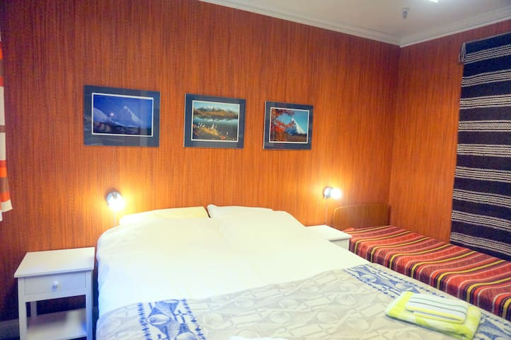 The room with a double bed and a single bed.