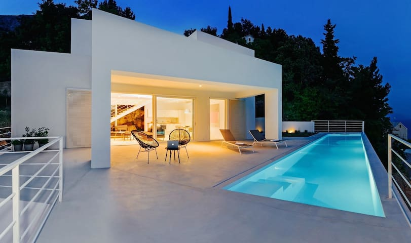 Sun deck area with 27m2 pool, lounge chairs and outdoor furniture