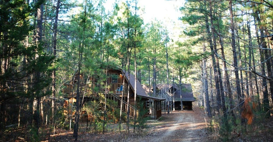View from driveway of two cabins