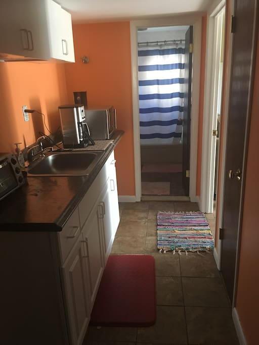 Private hallway with kitchenette and appliances between rooms
