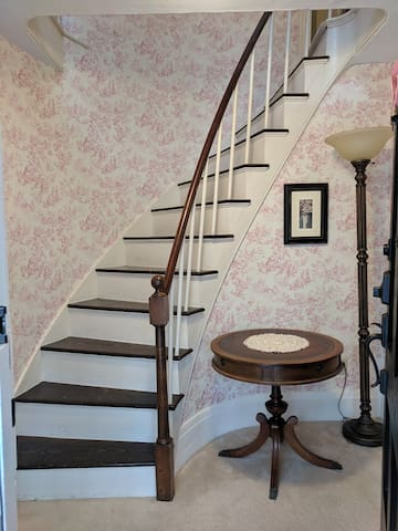 Entry from the porch--original spiral stairs. They're sturdy, but steep!