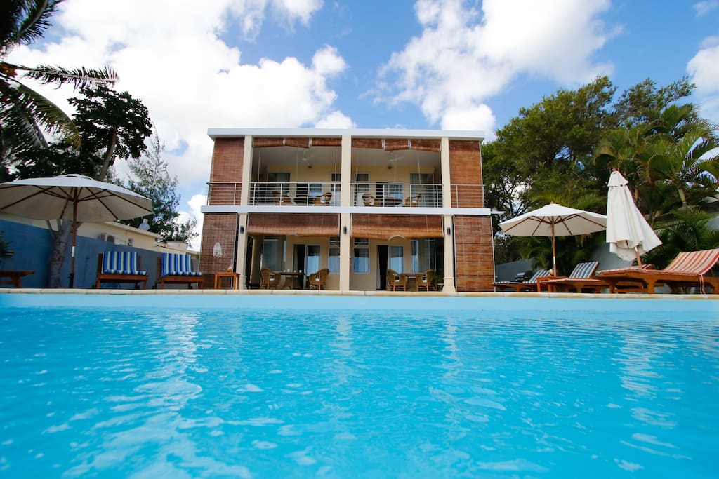 Four apartments with separate entrance - viewed from the swimming pool