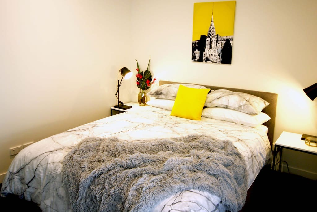 Luxuriously appointed main bedroom with Queen sized bed.
