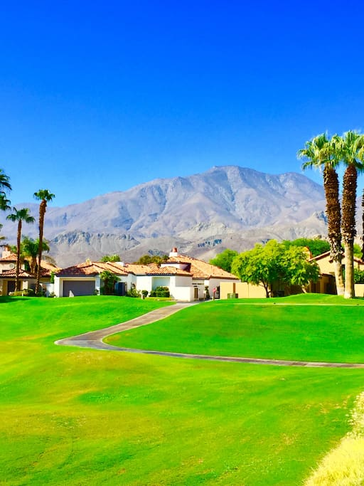 Front yard of single- level 3,000 square foot home on PGA West Jack Nicklaus Private.  Nobody across the street from you! Mountain View's from back yard.