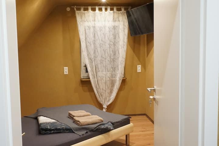 Lehmputz und Wandflächenheizung - Zimmer 2