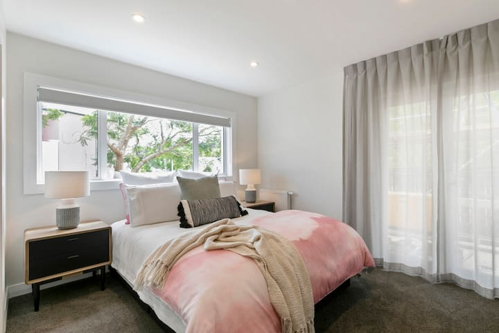Pretty in pink, bedroom six offers a comfortable queen bed, an ensuite and an overhead picture window