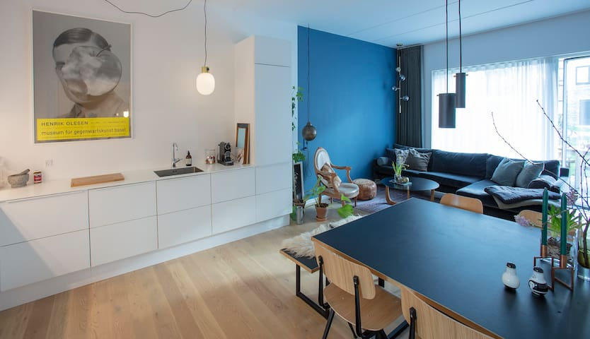 Modern habour side apartment with private garden
