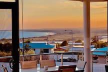 Enjoy a Burnt Orange View from the Sunrise Balcony