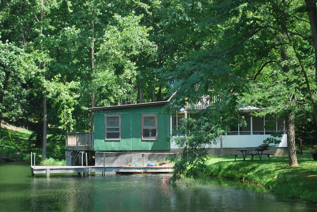 Classic Fish Camp sitting on the North Fork River with it's own pond