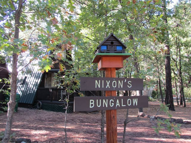 This beautiful wood-sided cabin is in the beautiful Pinetop amongst the pine trees.