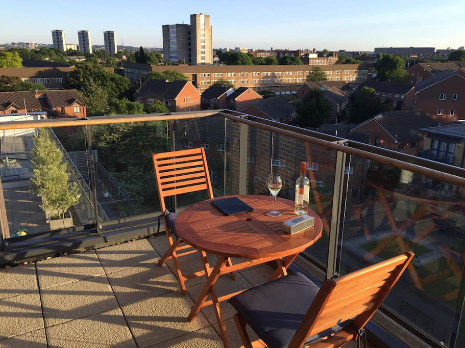 Sun terrace with views of Bermondsey and the Shard.