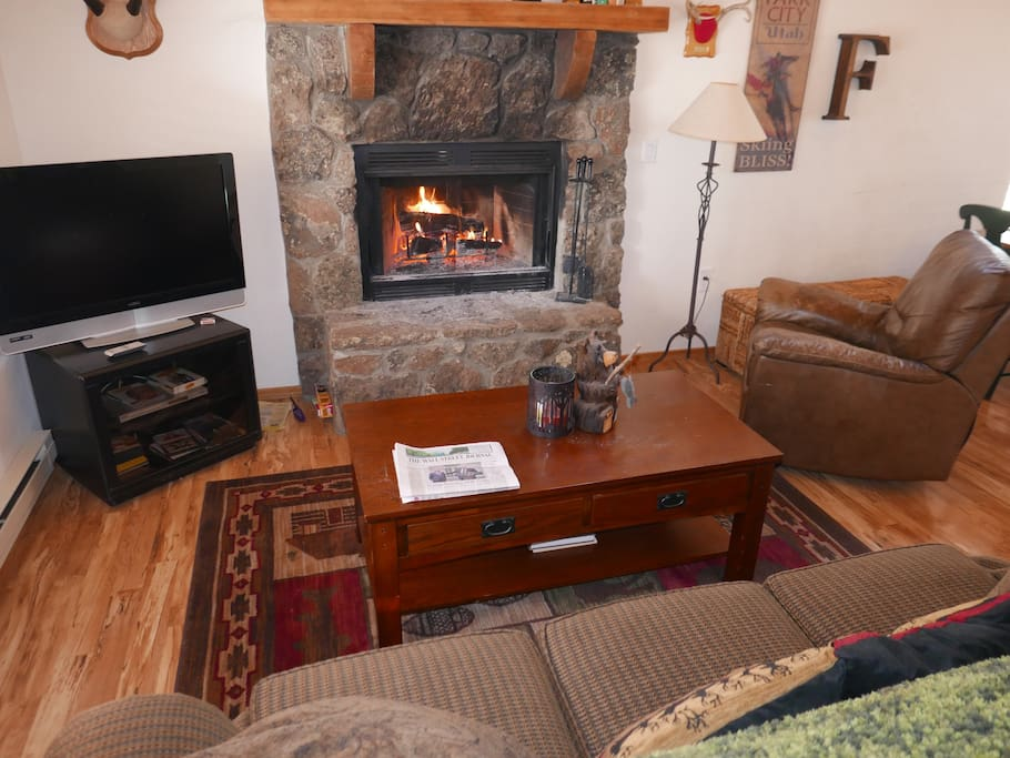 Comfortable living room with fireplace - real firewood!