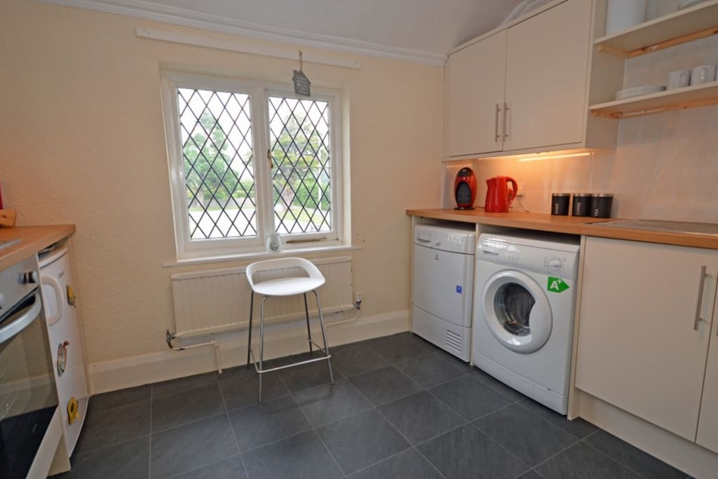 Residents kitchen, washing machine & tumble drier facility.