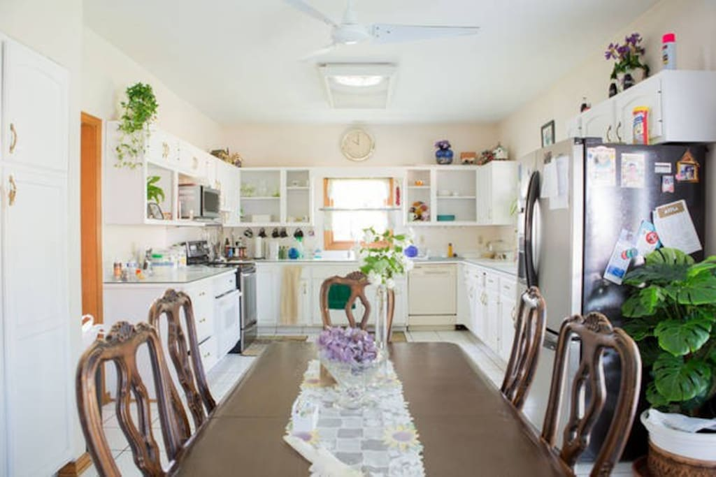 Spacious eat in kitchen with table seating 6 comfortably.