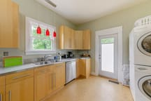 Kitchen window overlooking rear deck with side door leading to the deck. Laundry facilities to the right.