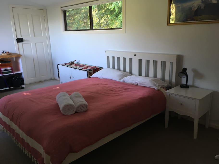 Bedroom with queen bed, nature views and private verandah