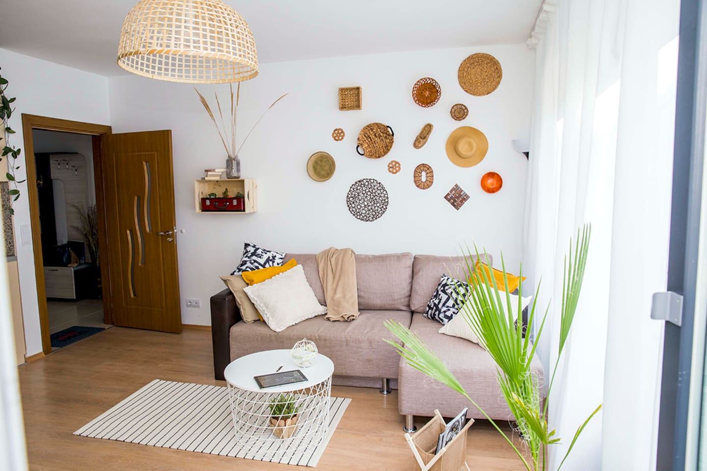 Spacious, cozy and full of natural light Living Room with lovely artistic decor.