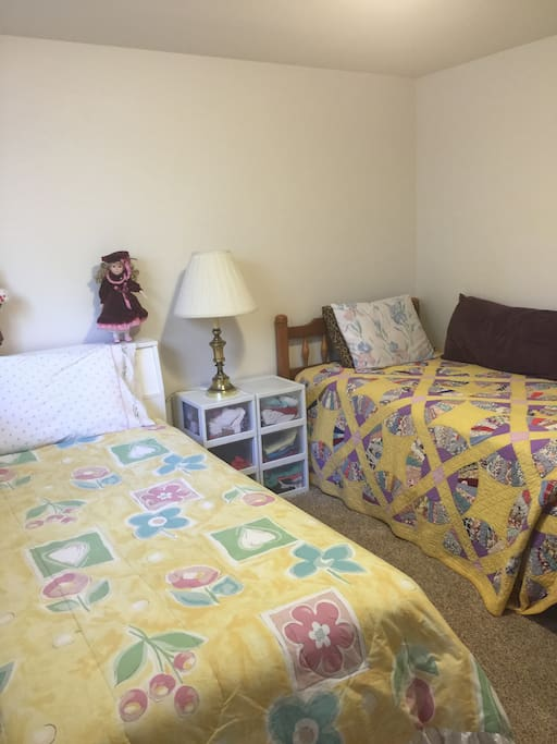 Second private bedroom with one double bed and one single bed