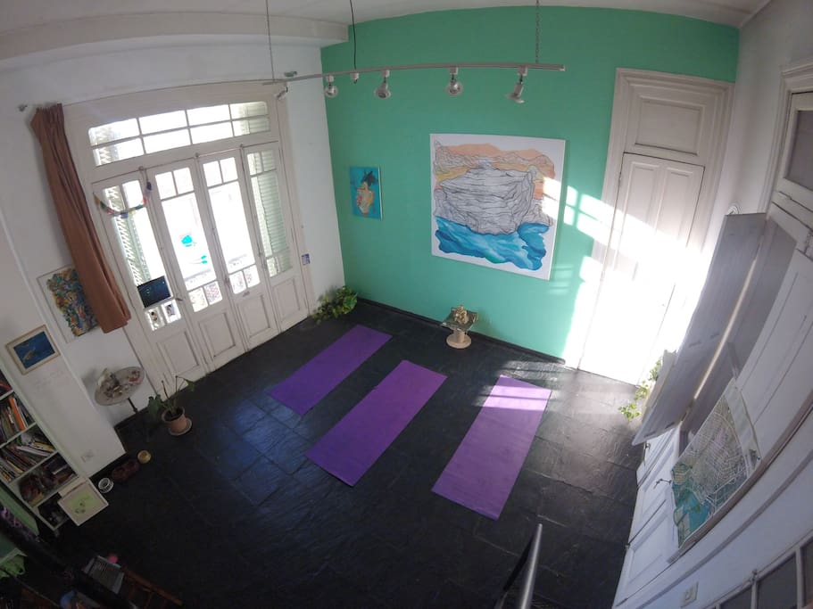 The yoga studio from upstairs currently has a couch, table and art studio set up. (Mezzanine view) [not a current photo]