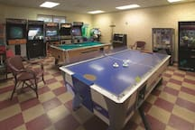 The Game Room with pool table, air-hockey and arcade in The Fitness Center.