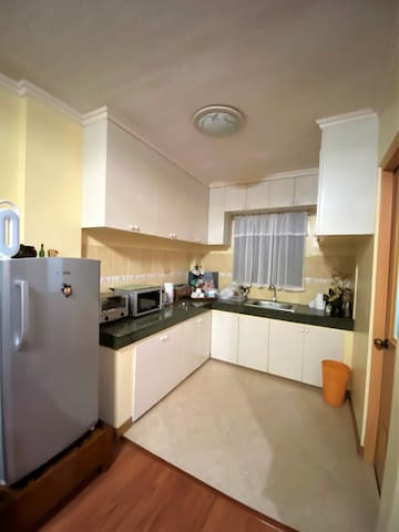 Kitchen equipped with a refrigerator, oven toaster,kettle and microwave. Utensils are also available.