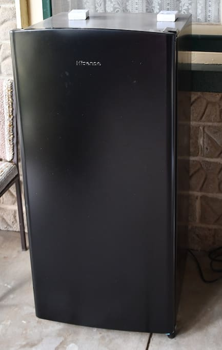 This refrigerator is in the Breezeway for guests to use