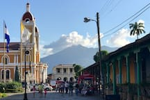 Entering Central Park and the tourist market area, as you walk from Casa Romantica, with Volcano Mombacho and the Cathedral ahead