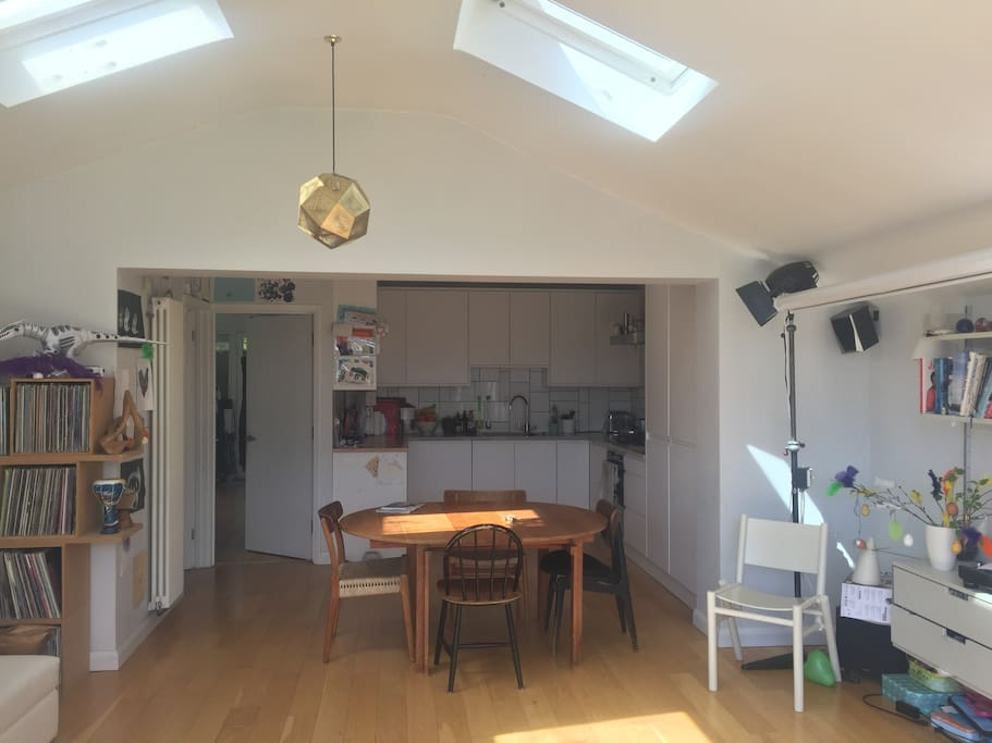 Looking back from the open plan living area to the modern and well equipped kitchen. The utility room is to the side of the kitchen (with washer & drier).