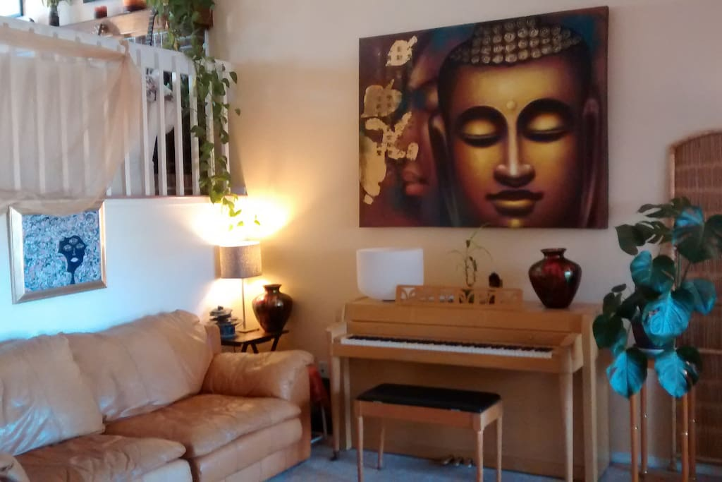 Bright, warm welcoming entry level living room-the Golden Buddha Room. Yes, please play the piano!