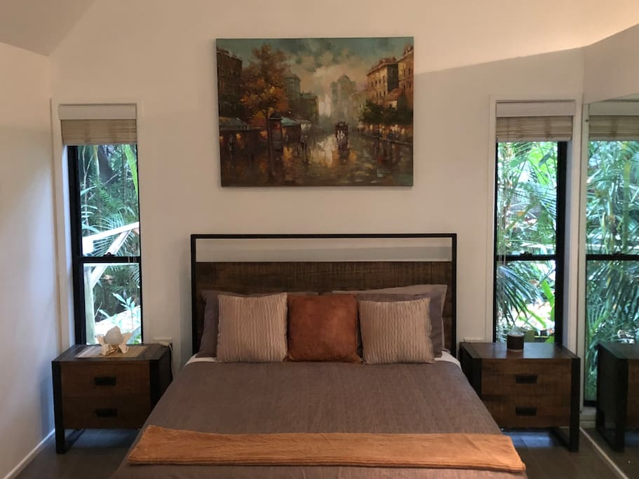 Queen size bed set in a beautiful rainforest feel