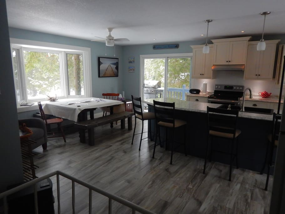Beautifully renovated upper level kitchen with views all around and wrap around porch