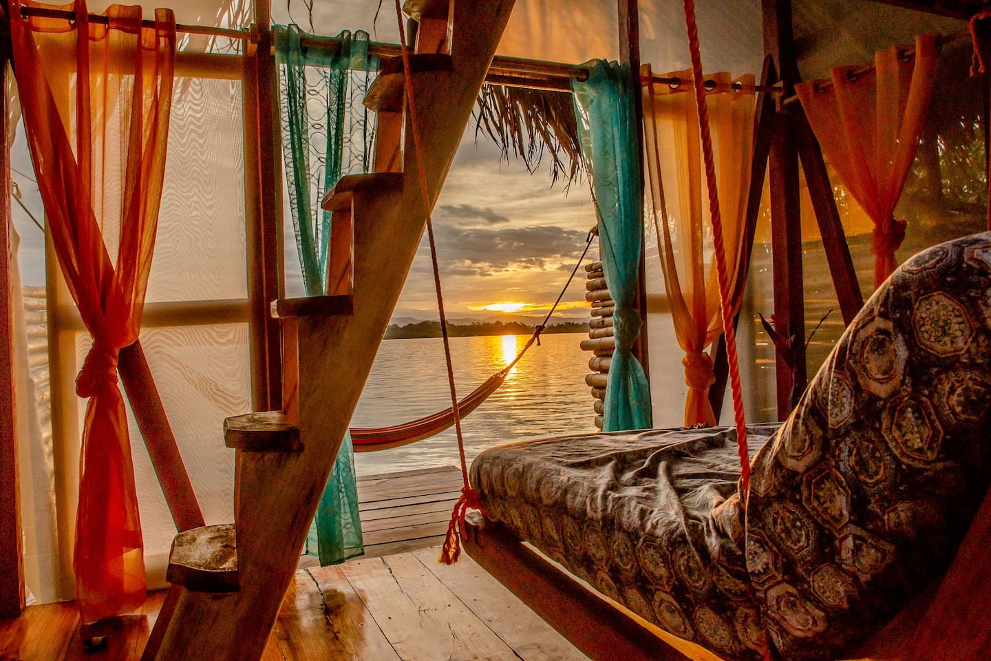 Sunset from the hanging sofa on the ground floor of your loft!
