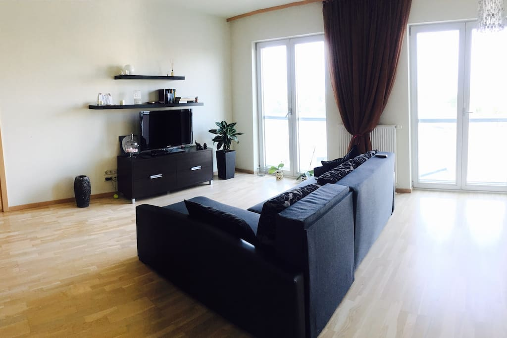 Wide and sunny living room with sofa what can easily transformed to double bed. Interactive TV with more than 400 different channels and optic internet. Wide windows with panorama view.
