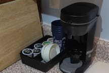 Self serve coffee maker in kitchen for guest use.