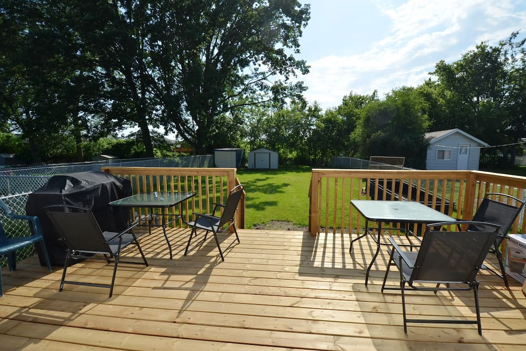 back deck with BBQ and patio furniture, note the fenced dog run on the left