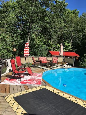 Plenty of seating and umbrellas around the pool.