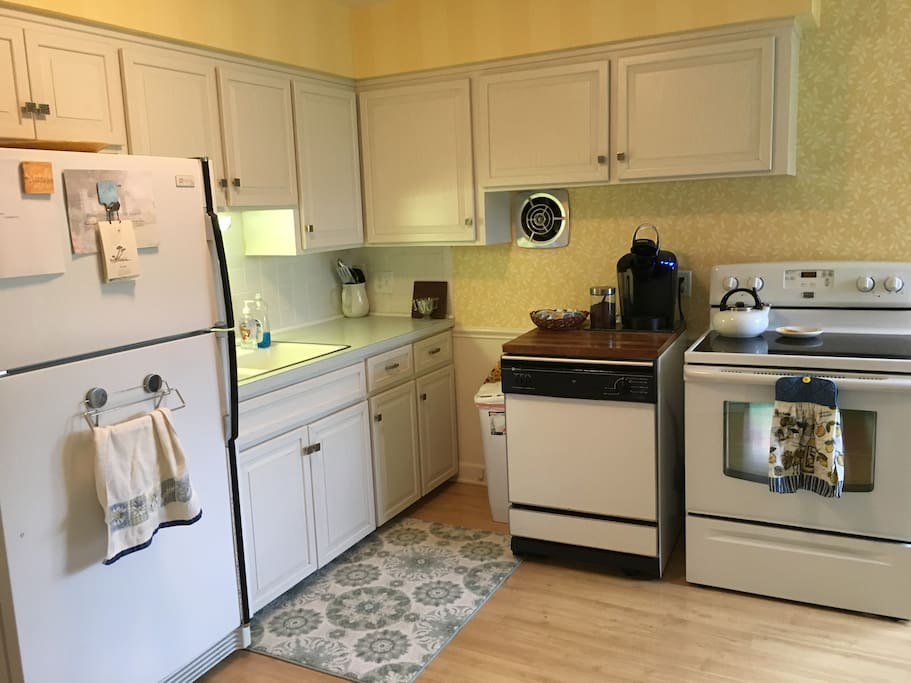 Fully equipped kitchen with a Keurig coffee maker and a variety of coffee pods