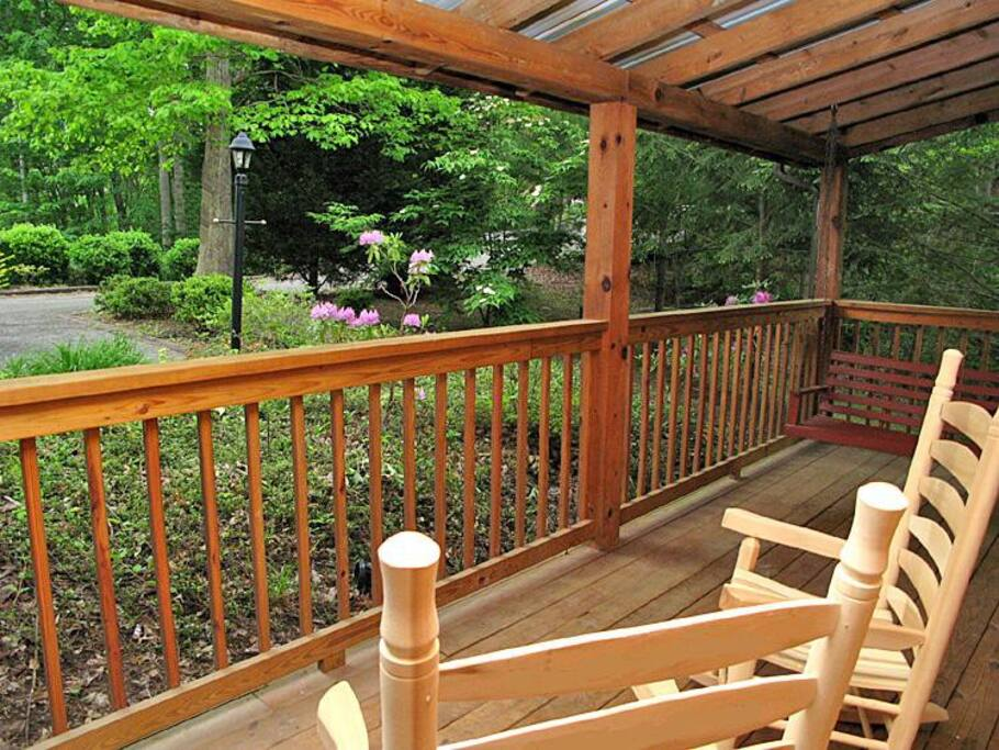 Easy does it - A porch swing and rockers are mountain-cabin essentials. Once you sit back in one, you'll immediately get into the