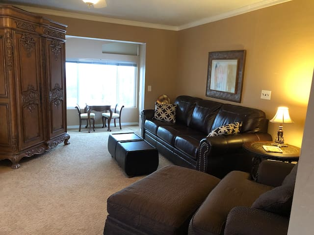 Den/secondary bedroom.  Features an awesome leather couch which converts to a comfy queen pull out bed with memory foam mattress.  Huge soft, sink-in chair with ottoman, perfect for gazing at the view, just relaxing or watching cable TV.