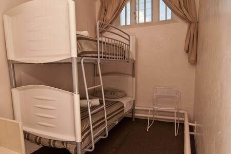 Twin bunk/shared dorm