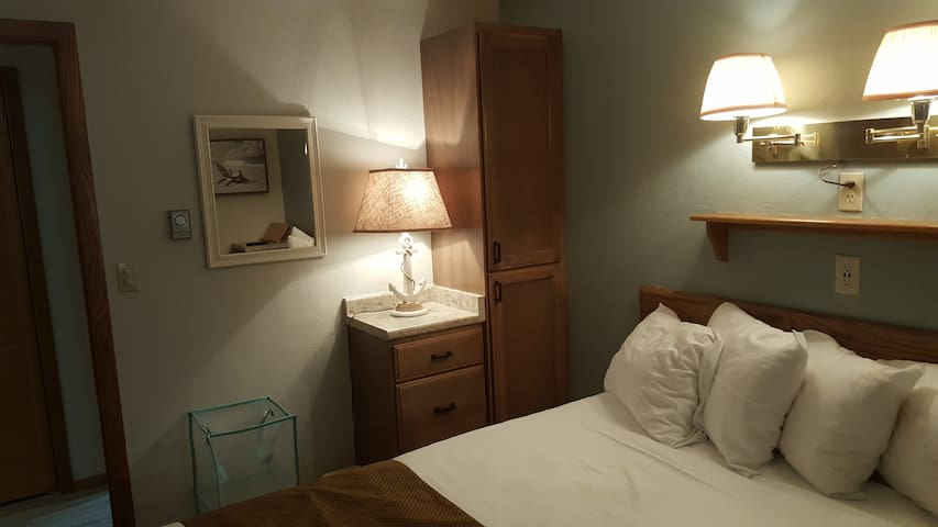 Separate bedroom has king size bed with triple sheeted bedding.  Flat screen TV