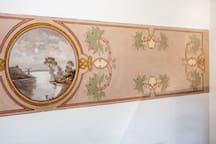 The living room is enriched by a fresco from the early twentieth century.