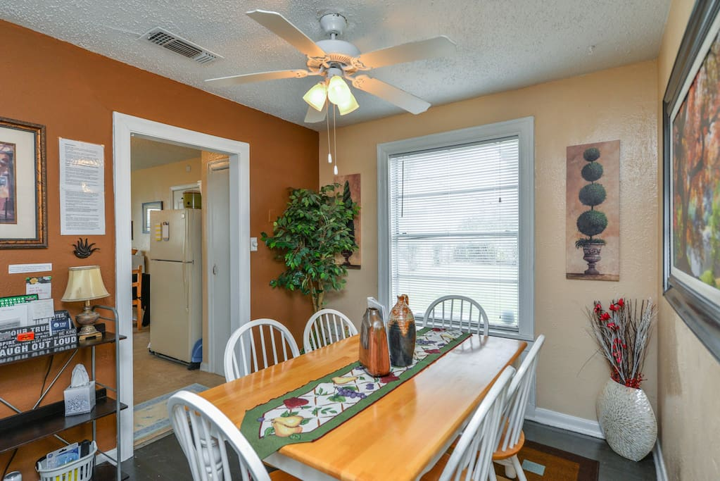 Living area opens up to dining room table that seats 6.  Additional table and seating in large kitchen.