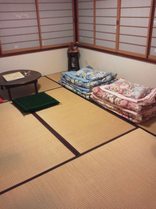 """In the night time, that same room is guest room. You can use """"futon"""" on the """"tatami"""" for 1 or 2 people. It is Japanese traditional style!  お泊り頂く6畳個室。夜の様子。~2名様までは、お布団をご利用頂けます。"""